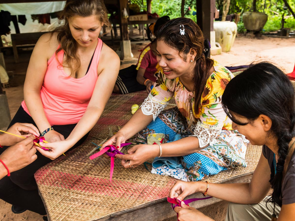Learning local crafts while on biking tour in Cambodia