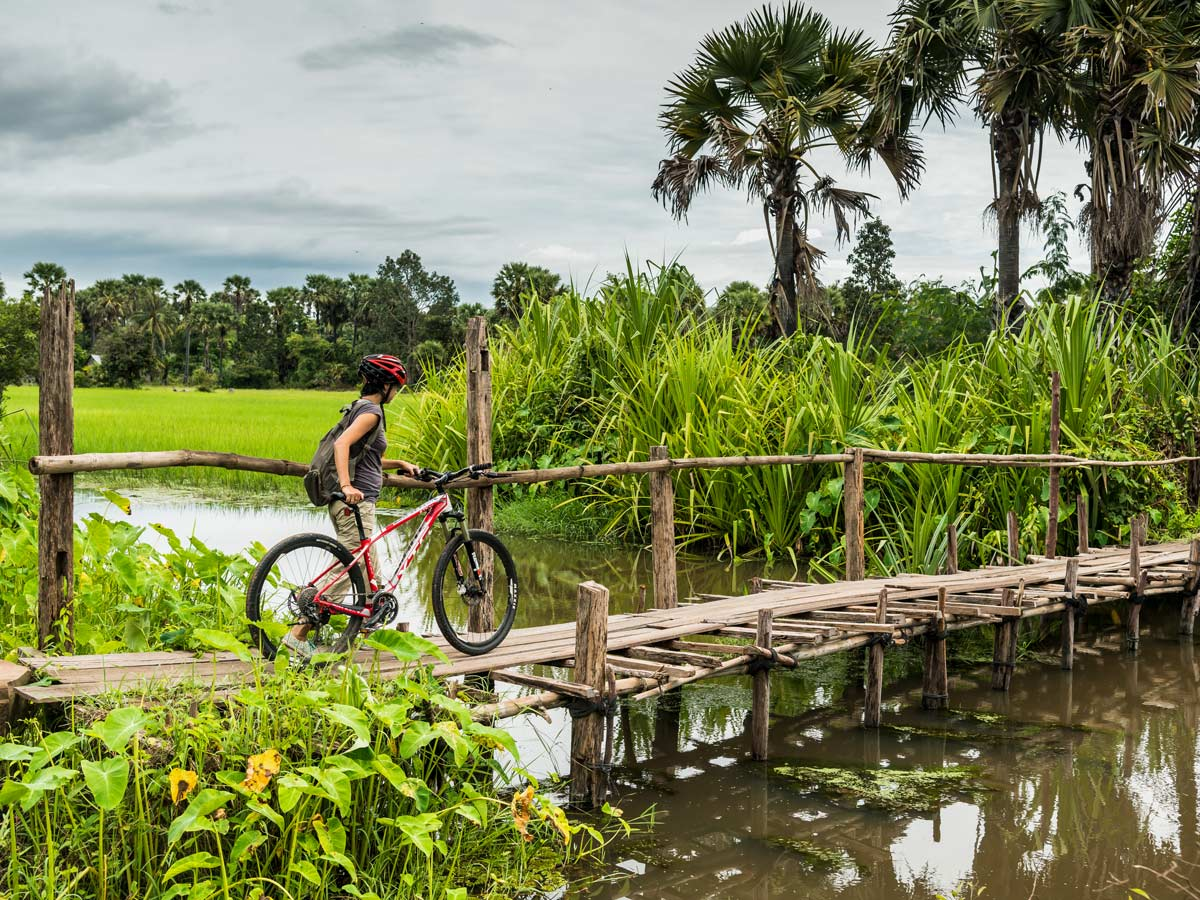 Crossing the bridge in Cambodia with a bicycle