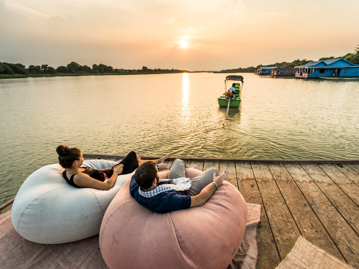 Bikers resting at floating village in Cambodia after a long biking day