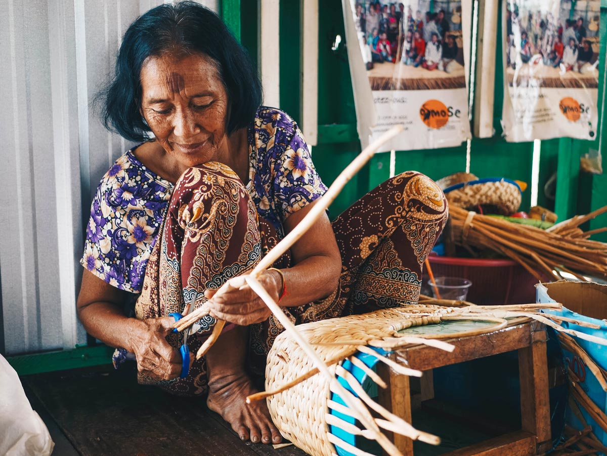 Cambodian woman making handmade crafts