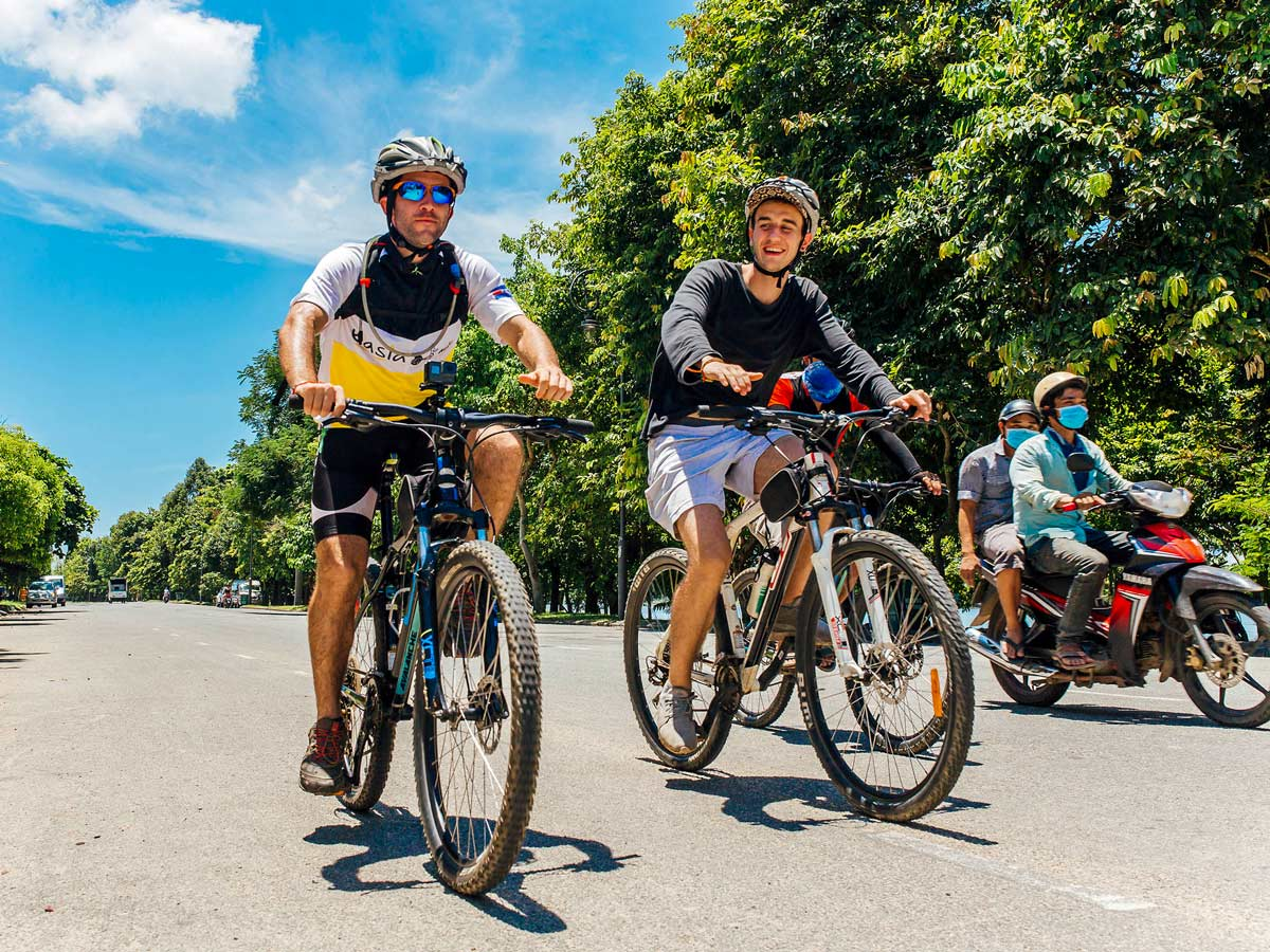 Happy bikers on cycling tour at Central Vietnam