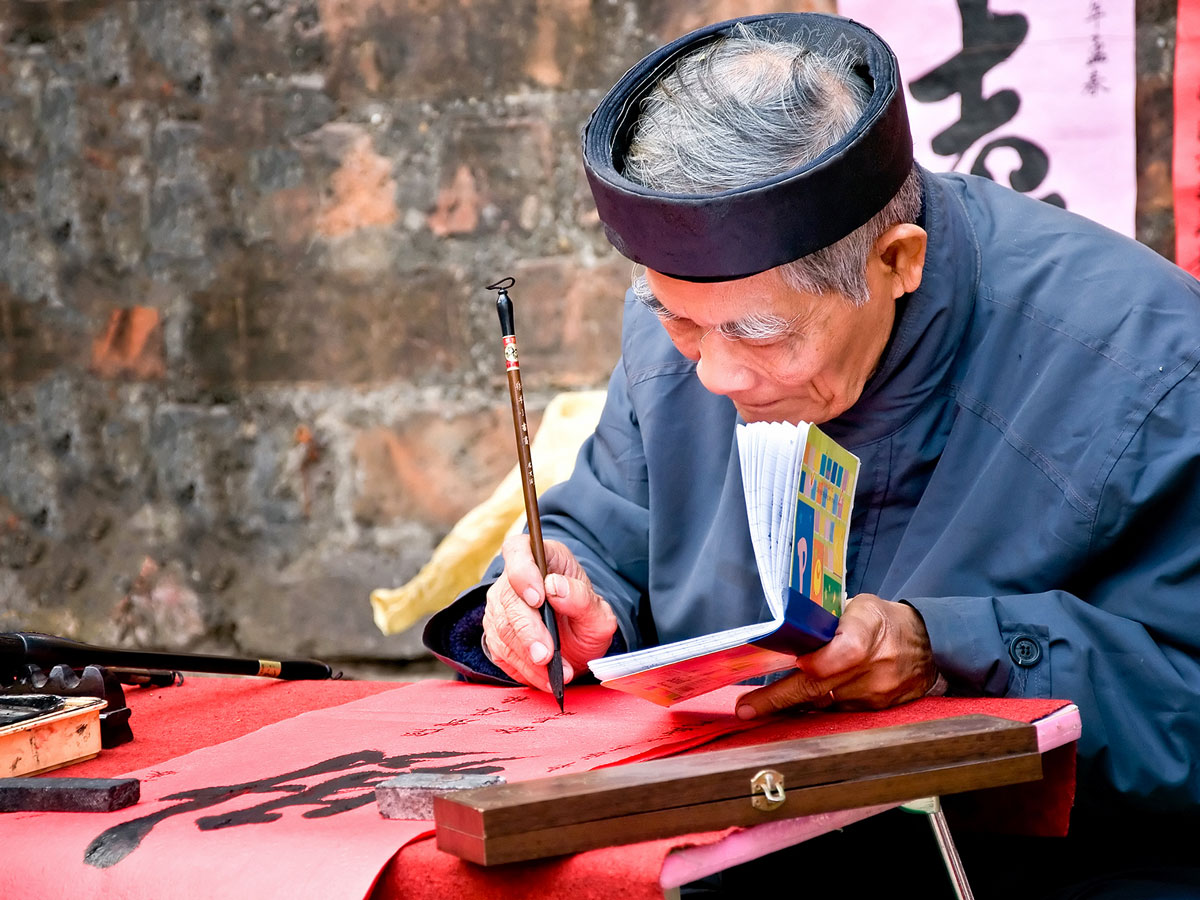 Old master writing at Hanoi