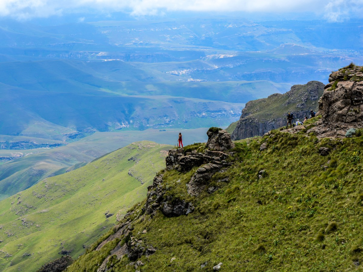 Woman standing in Drakensberg Mountains in South Africa