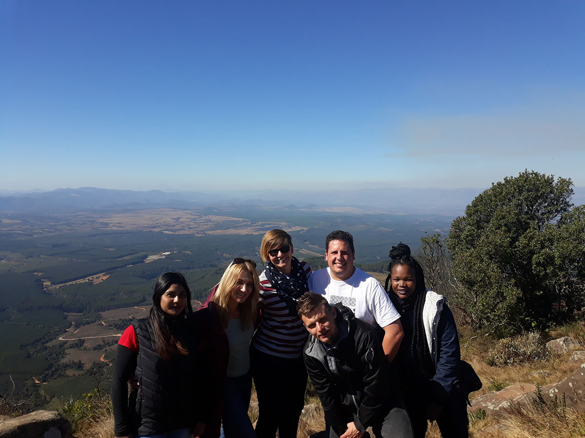 Group of hikers in South Africa posing in front of expansive views