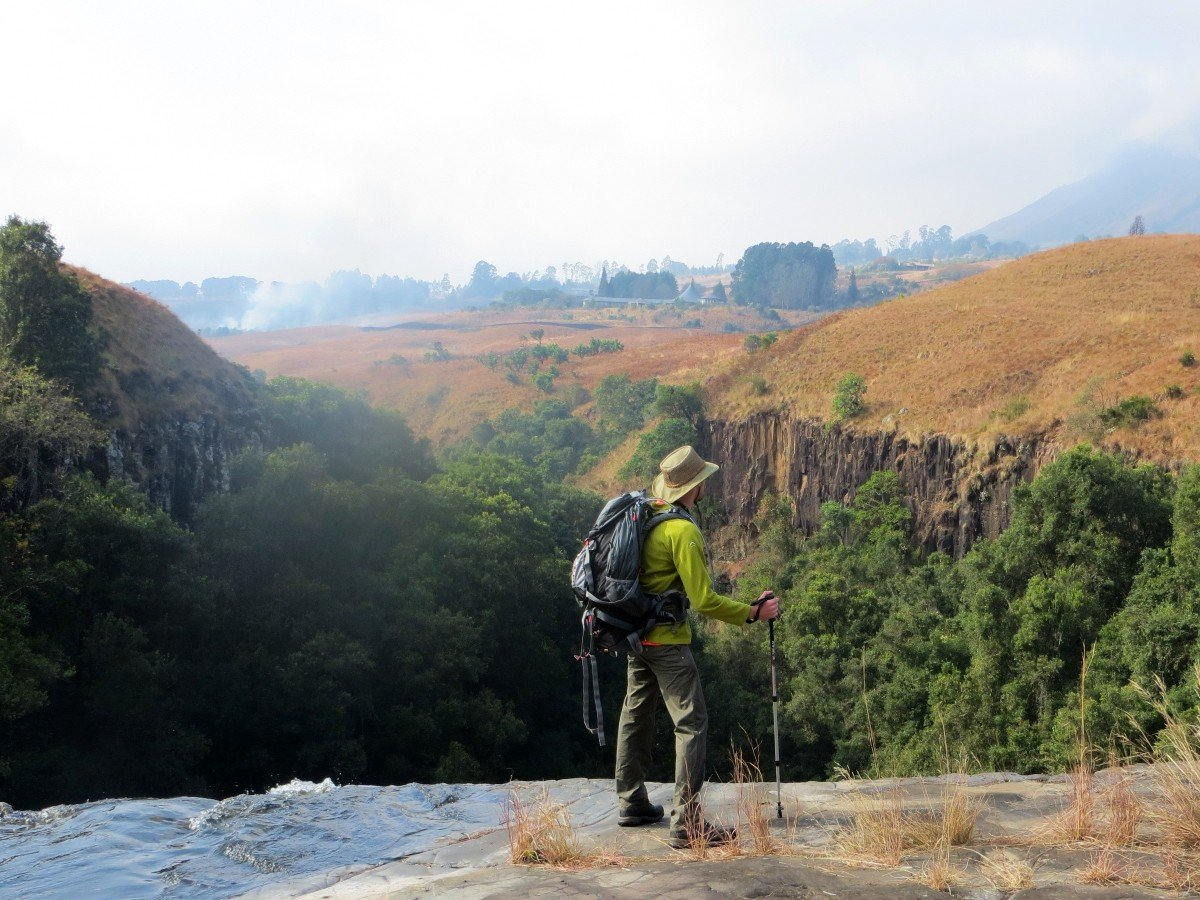 Hiker in Drakensberg Mountains (South Africa), in front of expansive valley
