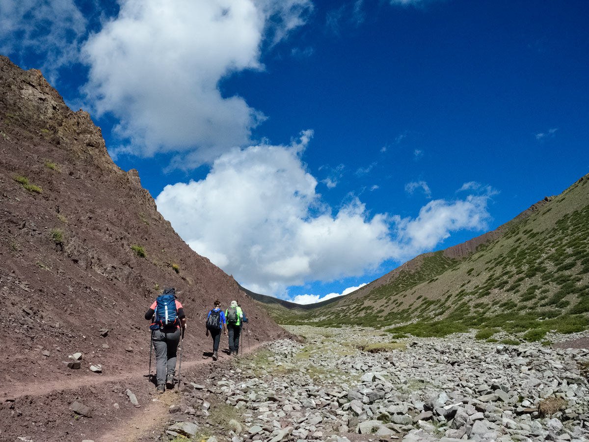 Hikers traverse valley mountains hiking near Ladakh Village India