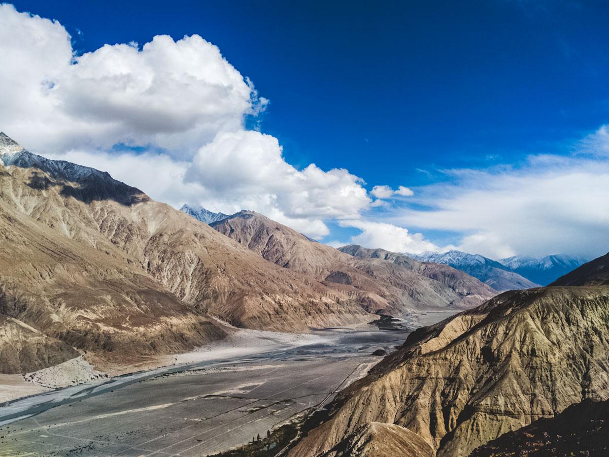 Hiking through beautiful mountians and valleys along Ladakh Village trek tour India