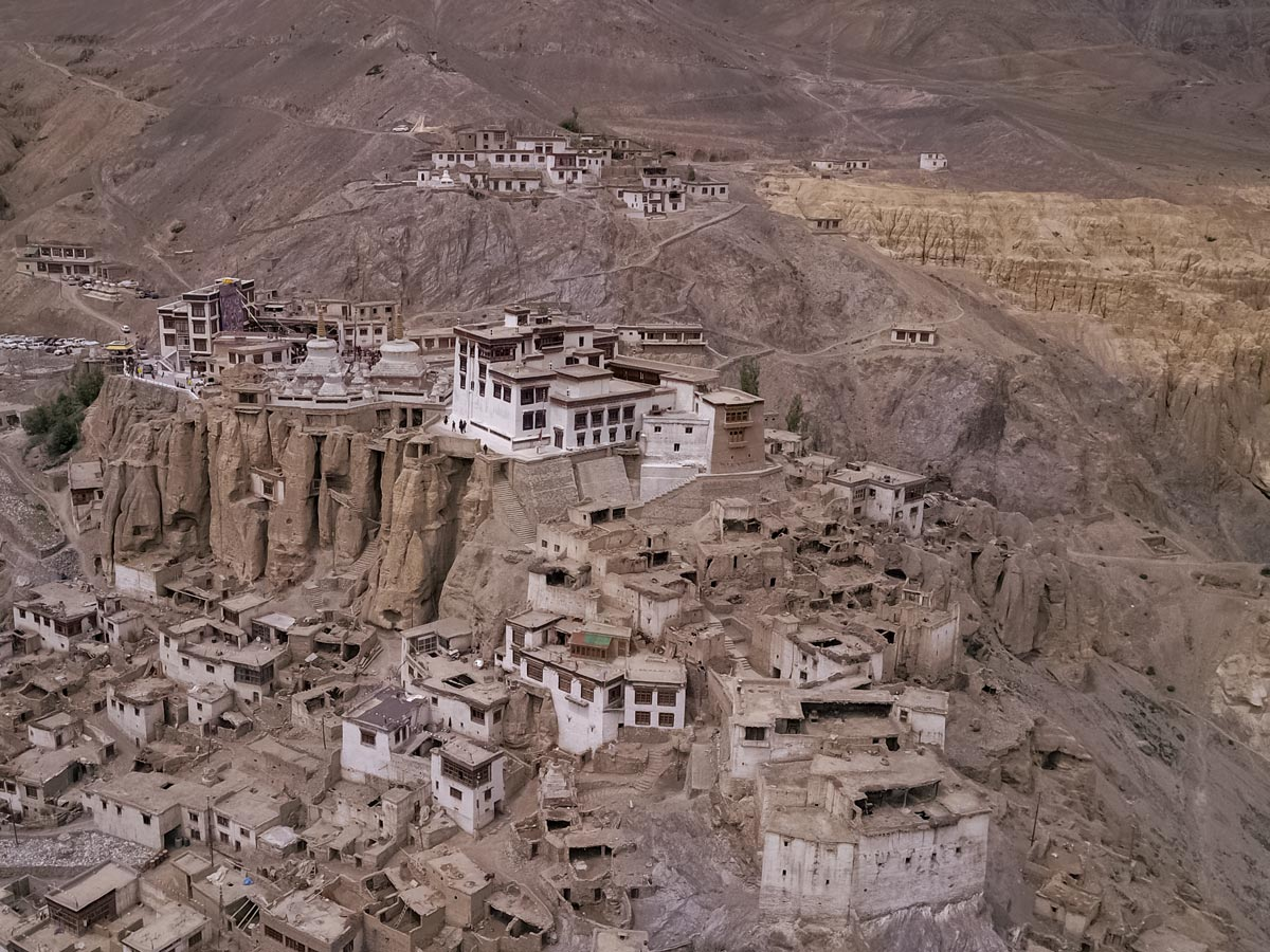 Ladakh Village on rock bluffs hoodoos seen hiking in India