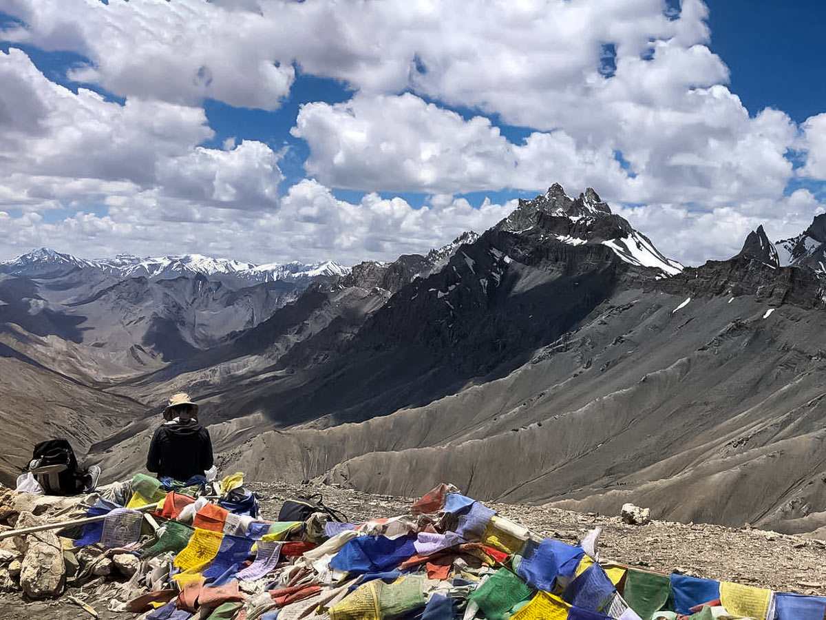 Colourful flags high in the mountains hiking Markha Valley in India trekking tour