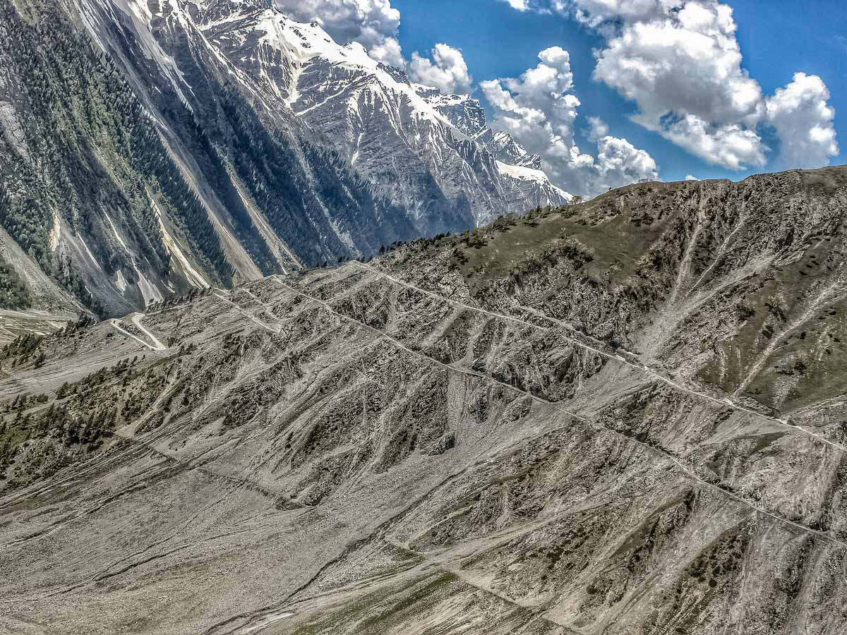 Road path cut into mountain side Nubra Valley hiking in India