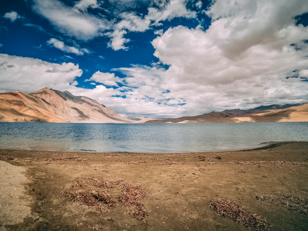 Beautiful reflections on the lake hiking around Parang La India