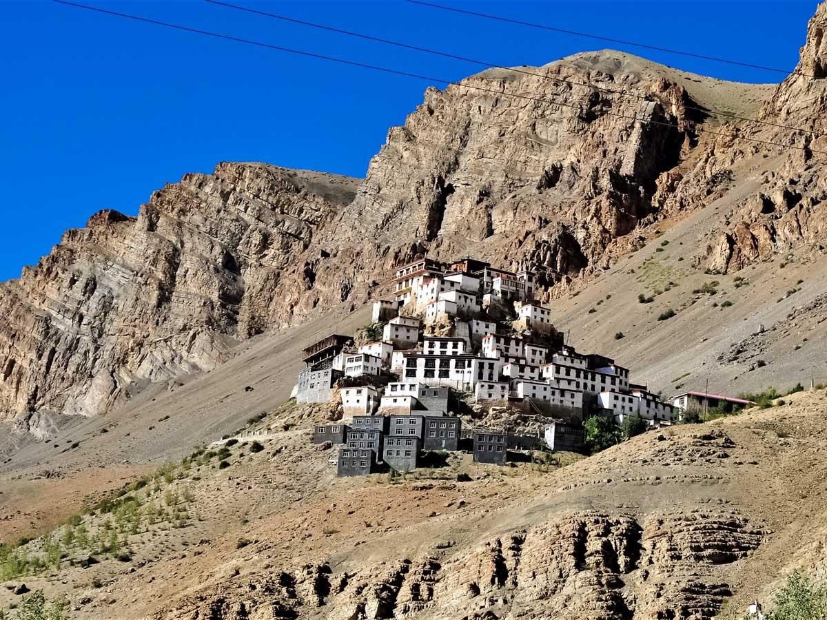 Hillside village monestary on mountainside seen on adventure tour in Parang La India