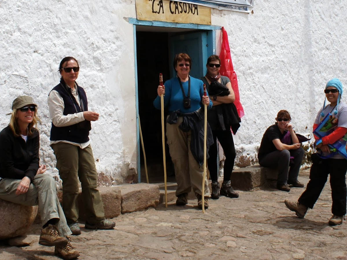 clients outside traditional Ollantaytambo house