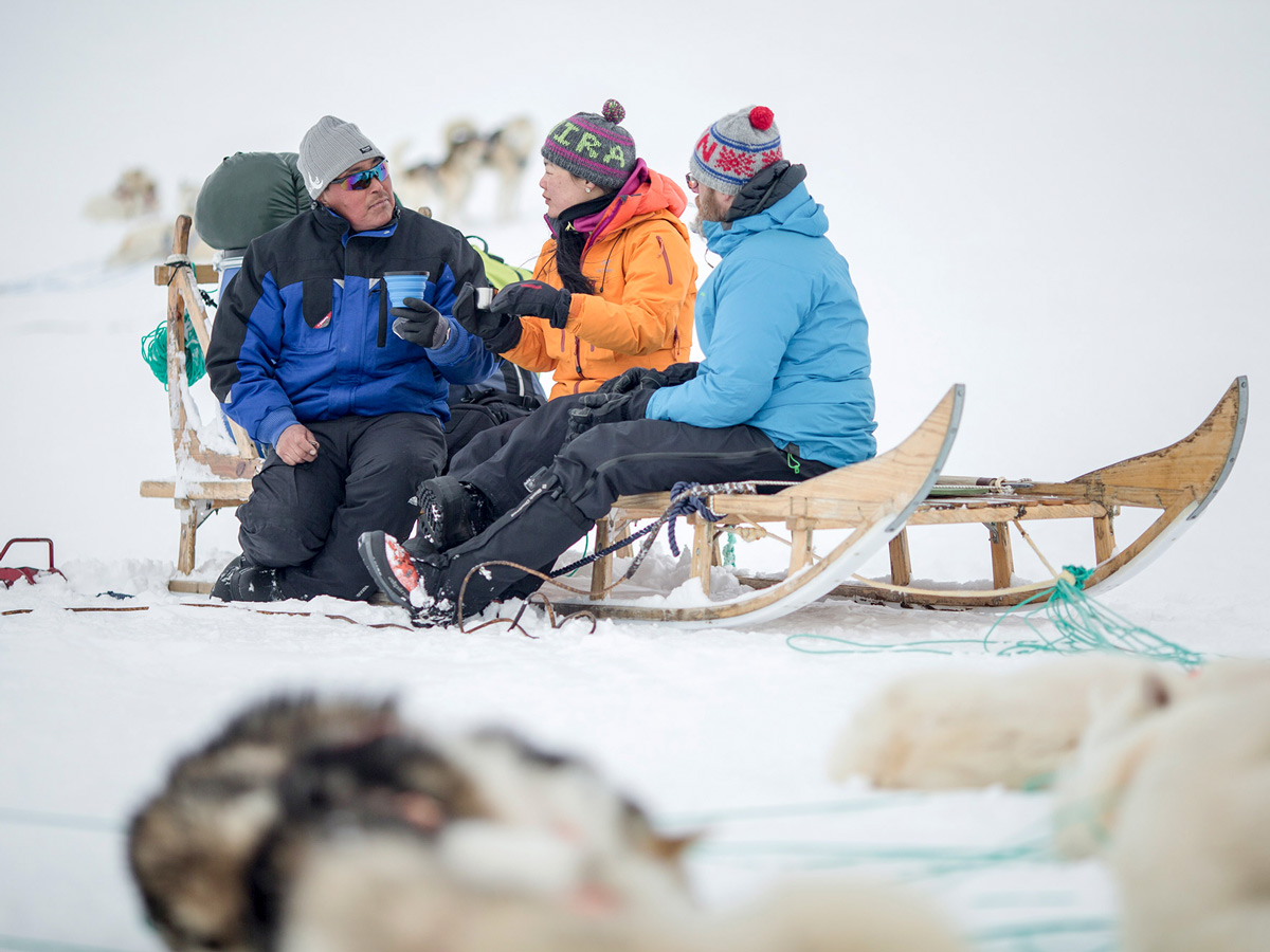 Dog Sledding tour group coffee break in Greenland