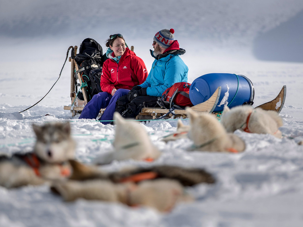 Resting with the sled dogs along Dog Sledding tour in Greenland