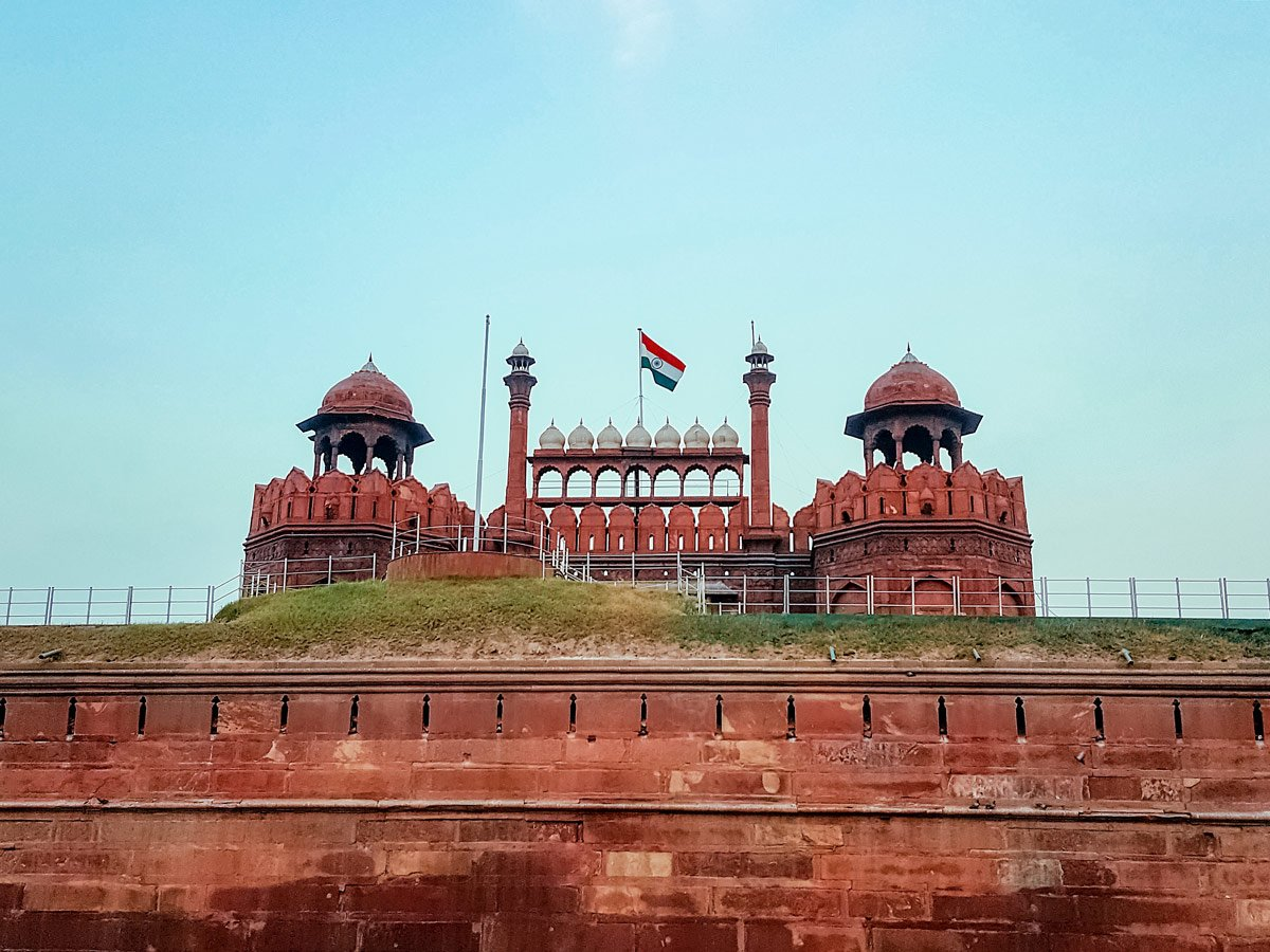 Indian flag flying over Red Fort in Agra India two day adventure tour