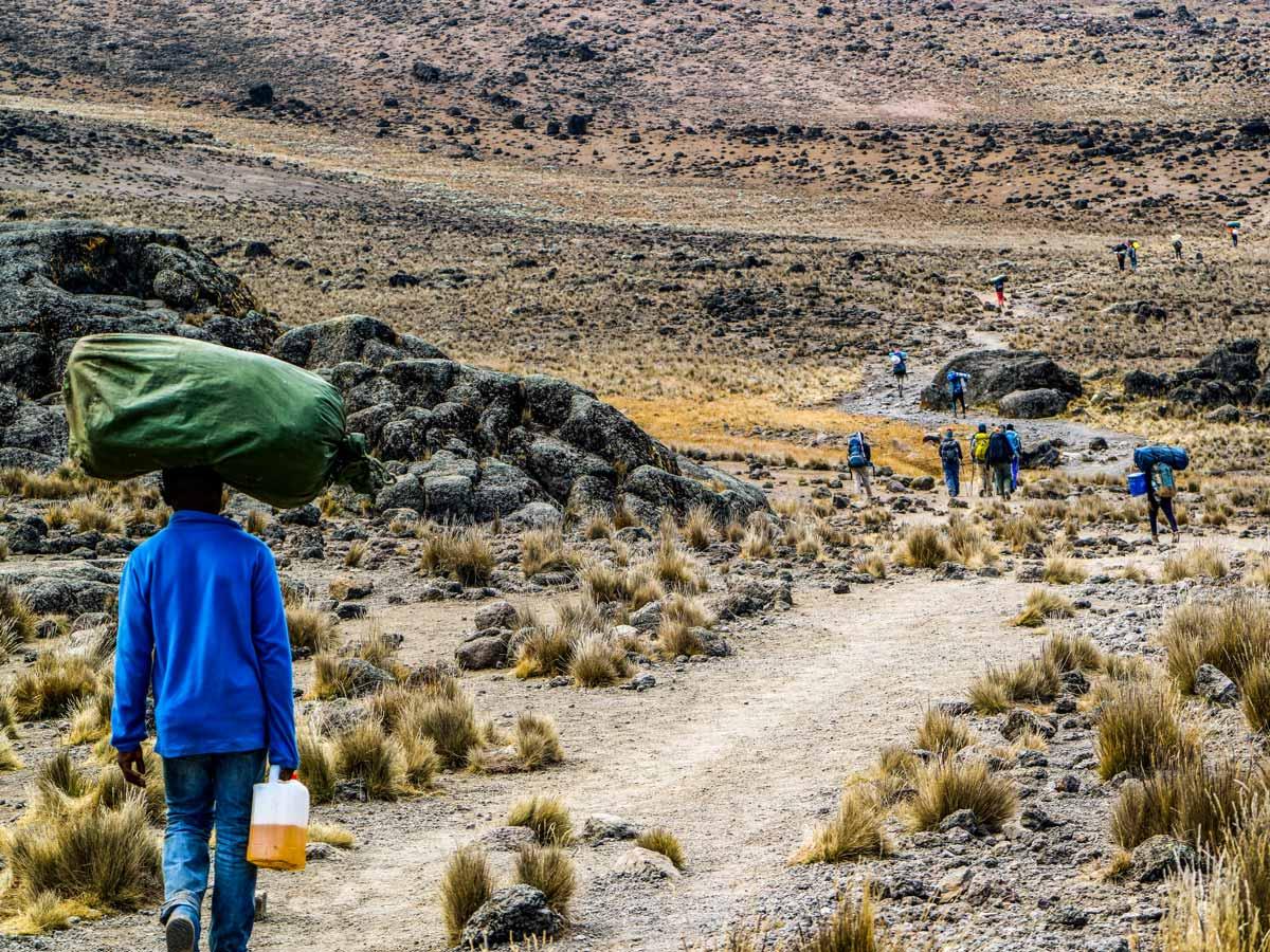 Machame trail hiking locals in Tanzania