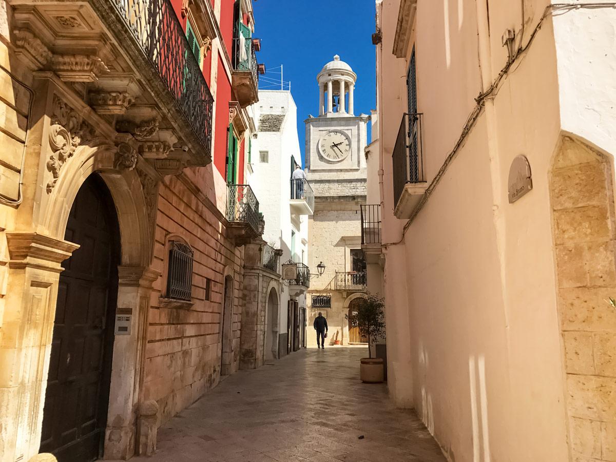 Beautiful old alley road Locorotondo adventure tour in Italy