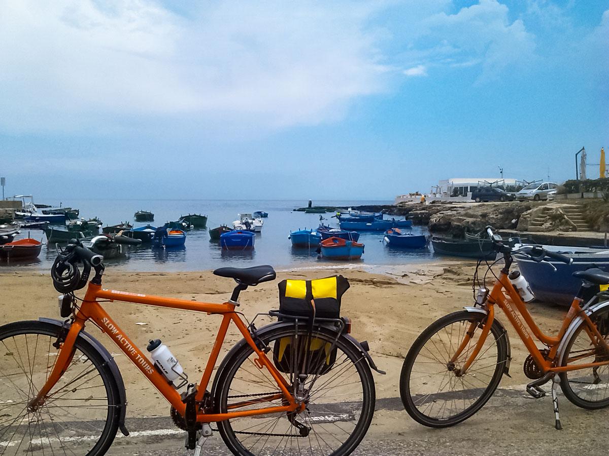 Polignano bikes by the ocean marina cycling tour Italy