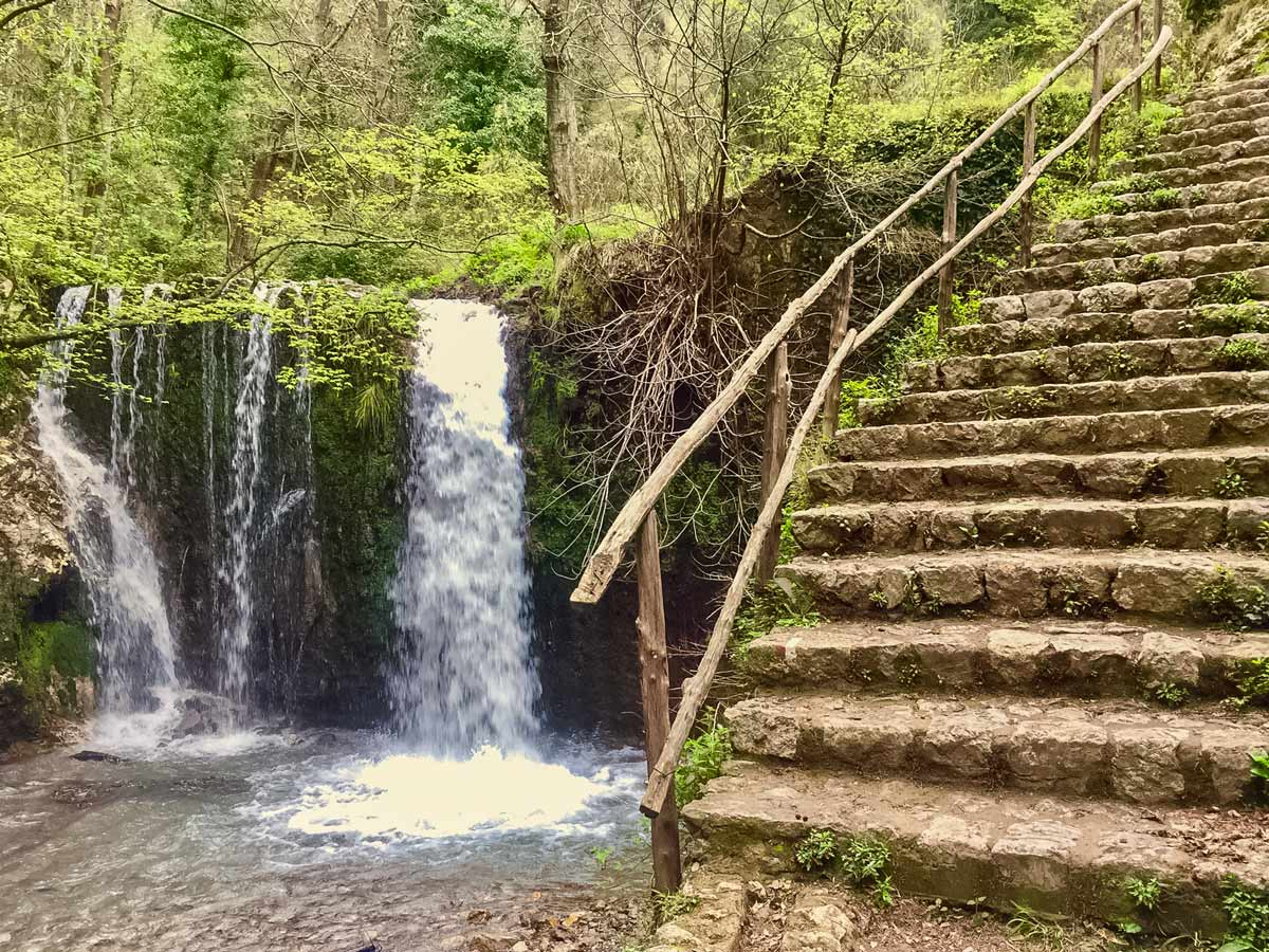 Waterfall and stone stairs in the forest walking Amalfi Coast Italy