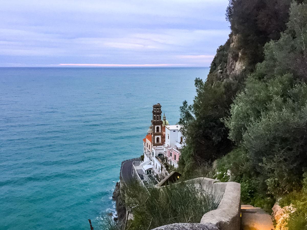 Towerroad buildings on ocean coast walking Amalfi Coast Italy