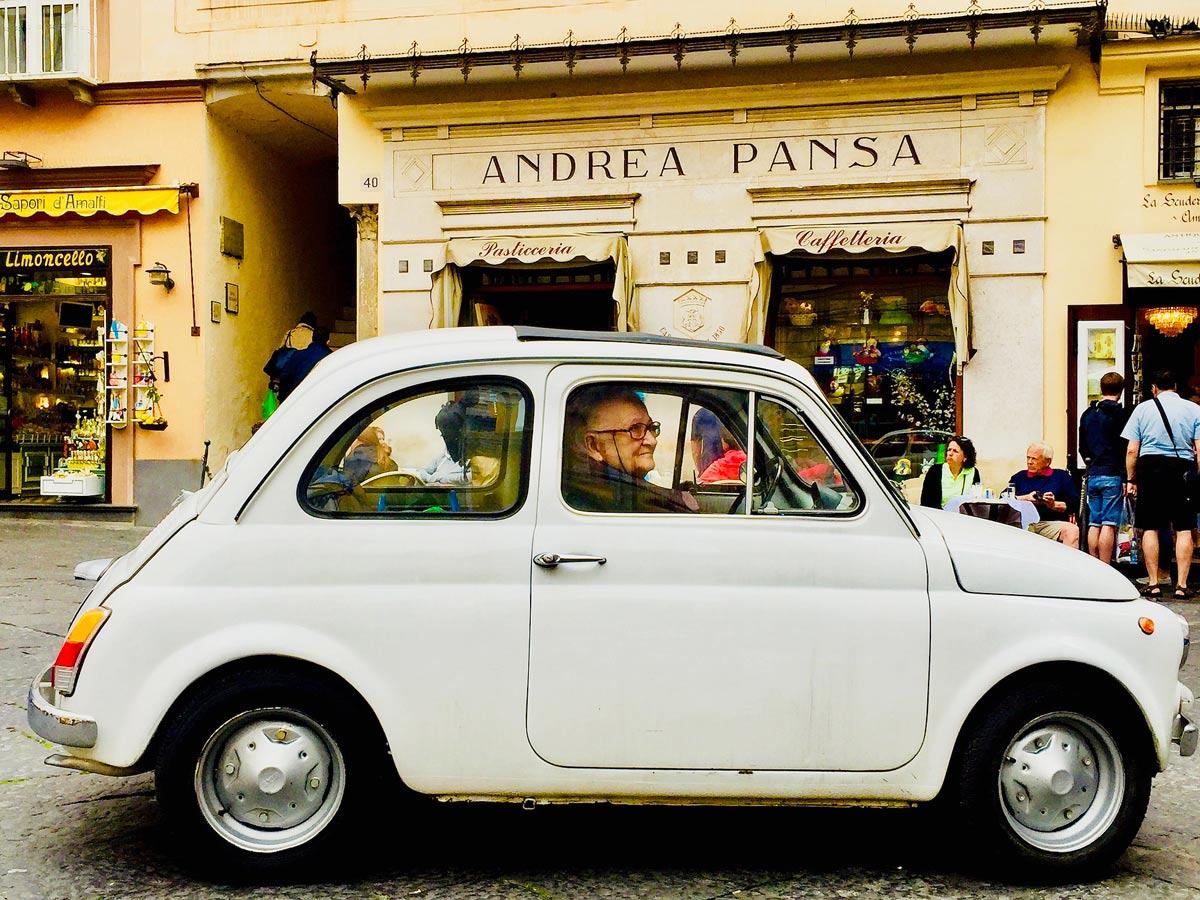 Vintage Italian car walking Amalfi Coast Italy