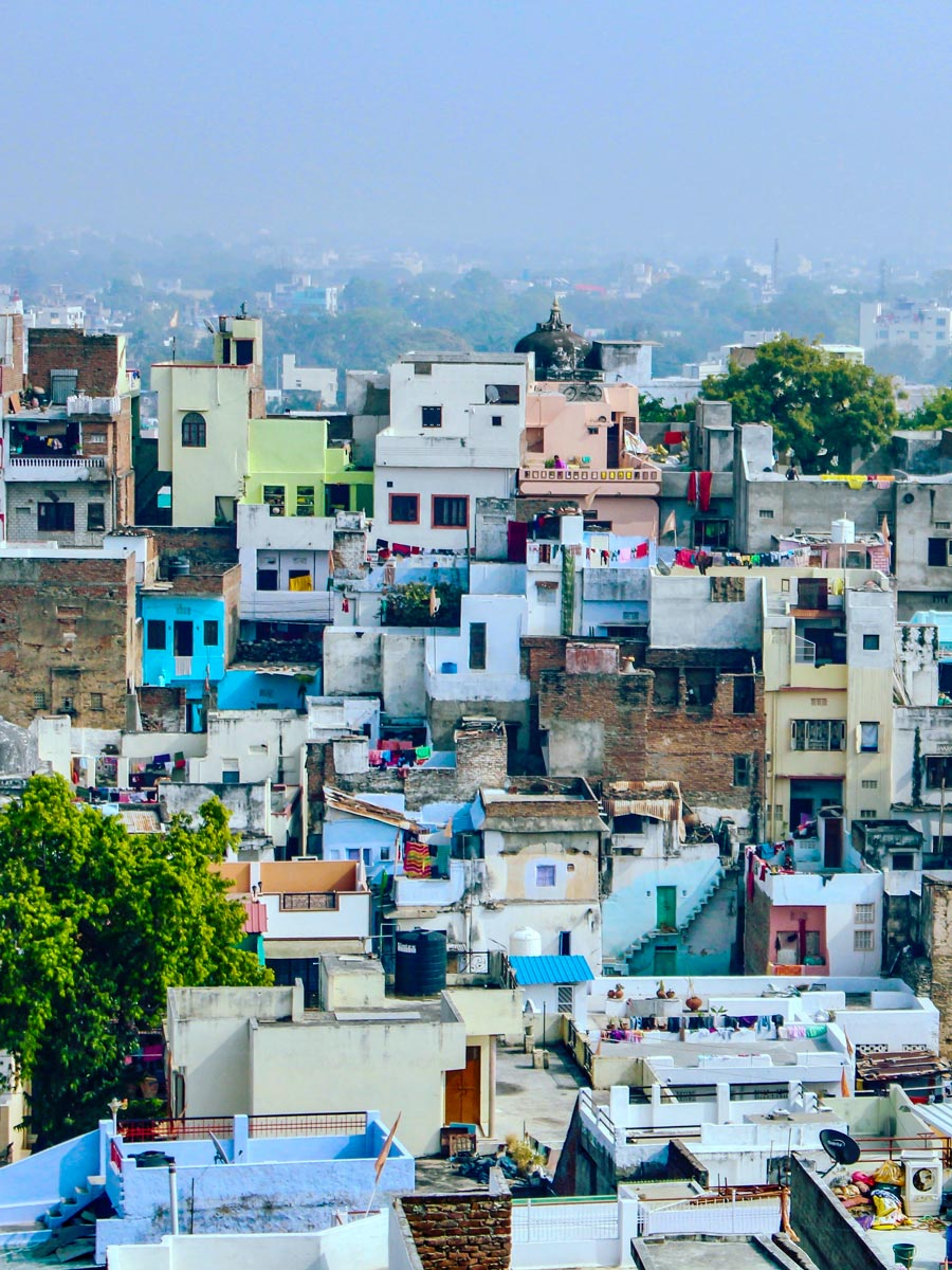 Udaipur colourful houses on the hillside India