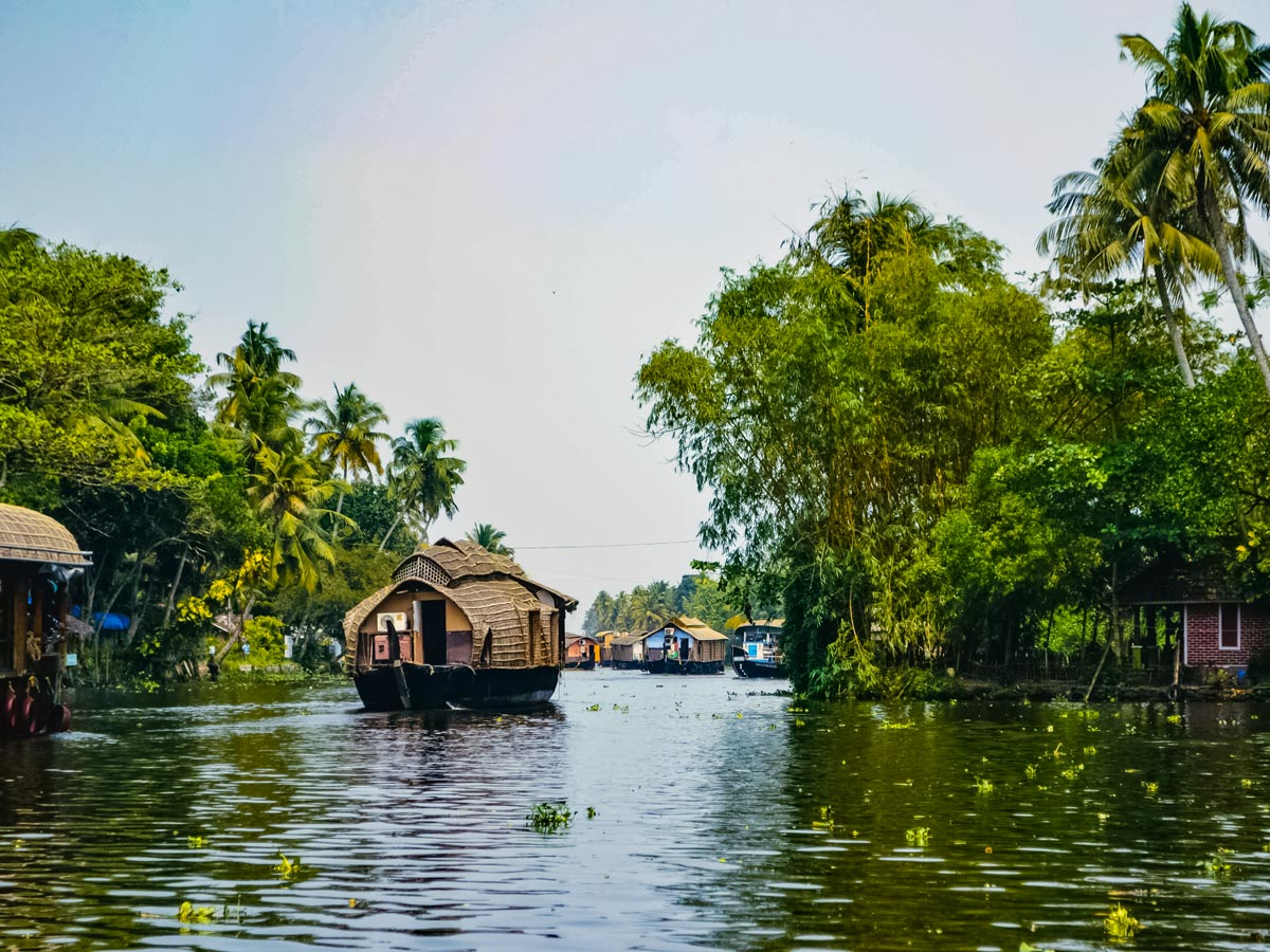 Riverside homes and houseboats in chanels of Kerala India