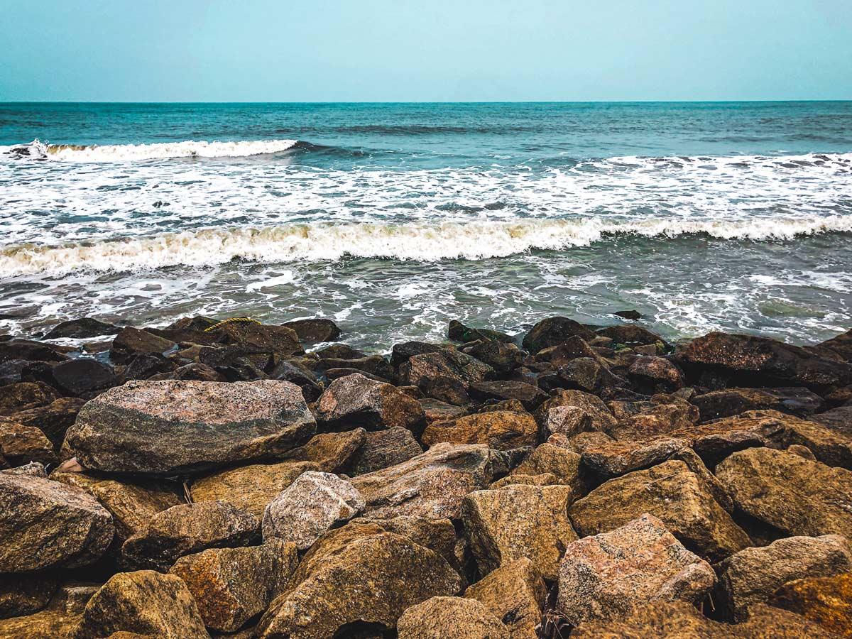 Kerala rocky ocean shore waves along adventure tour India