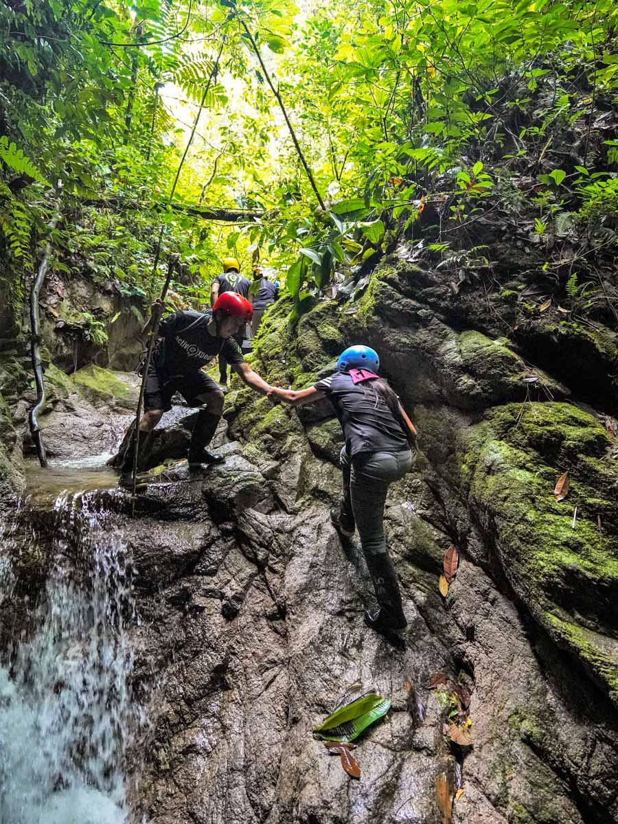 Climbing natural waterfalls along adventure tour photo Peru Ecuador