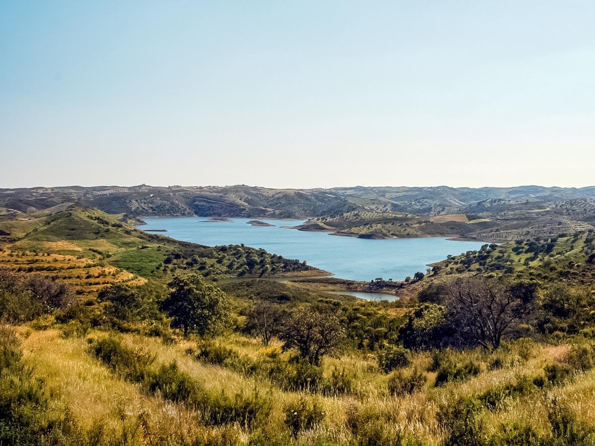 Road biking in Portugal beautiful countryside lake Barragem