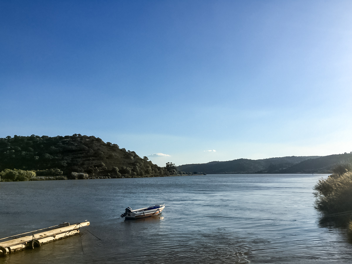 Road biking in Portugal adventure tour lake boat dock