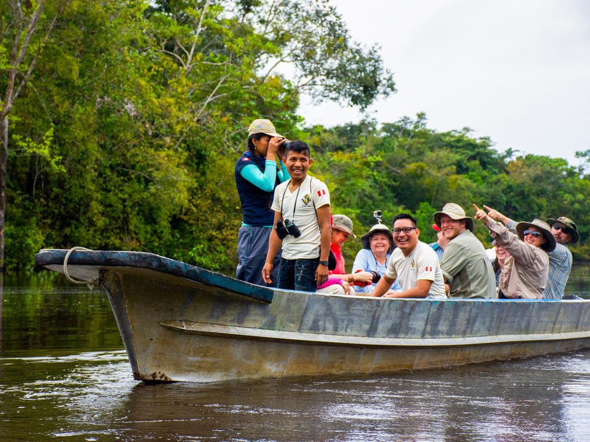 Boat tour birding expedition in the Amazon rainforest jungle Peru