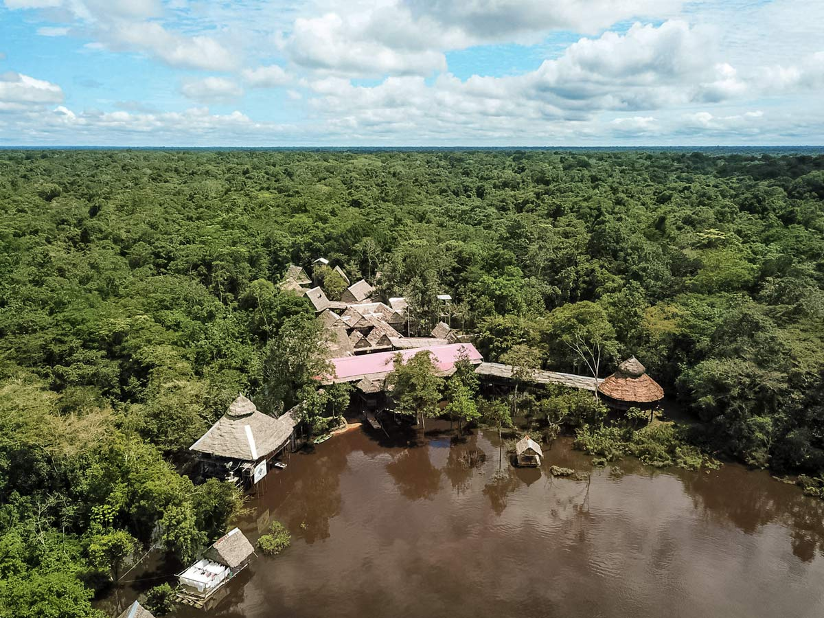 River front resort accomodations Amazon fishing expedition Peru