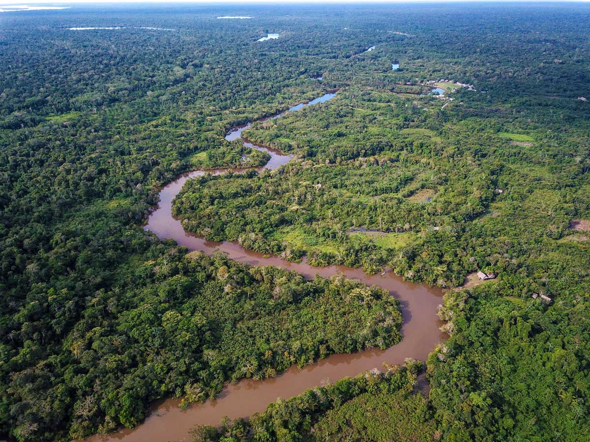 Meandering river in Amazon rainforest fishing expedition Peru