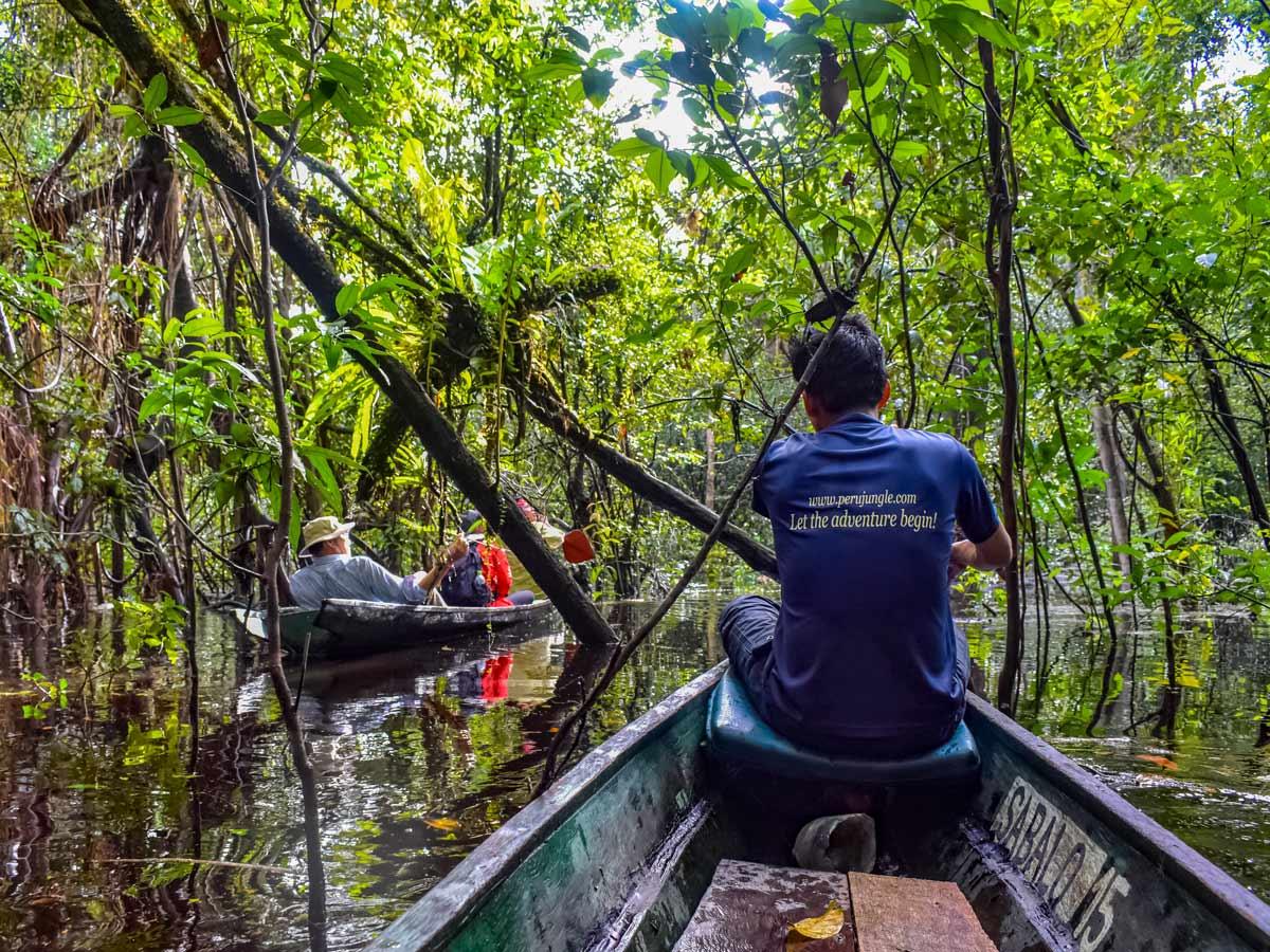 Peruvian Amazonia boats on the river fishing expedition Peru