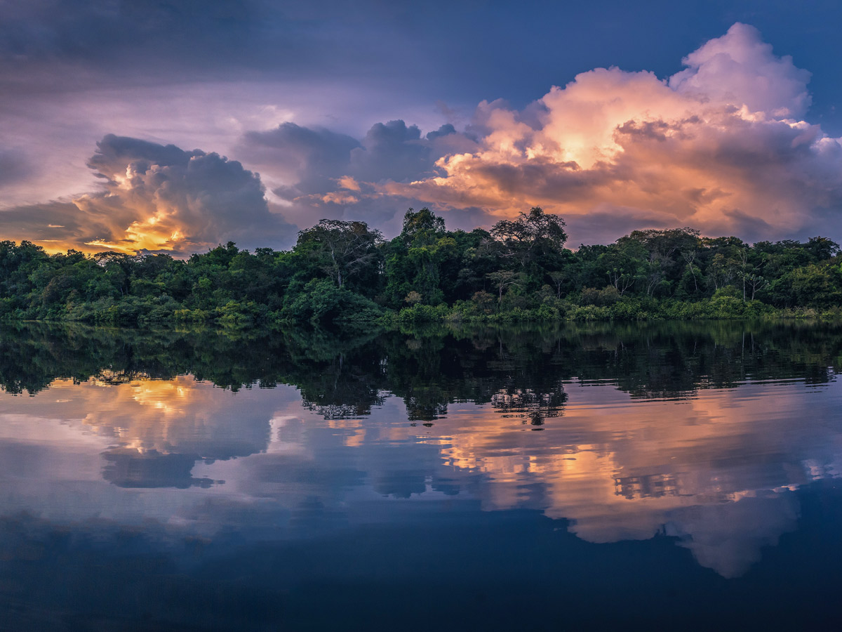 Amazon general tour beautiful sunset river rainforest Peru