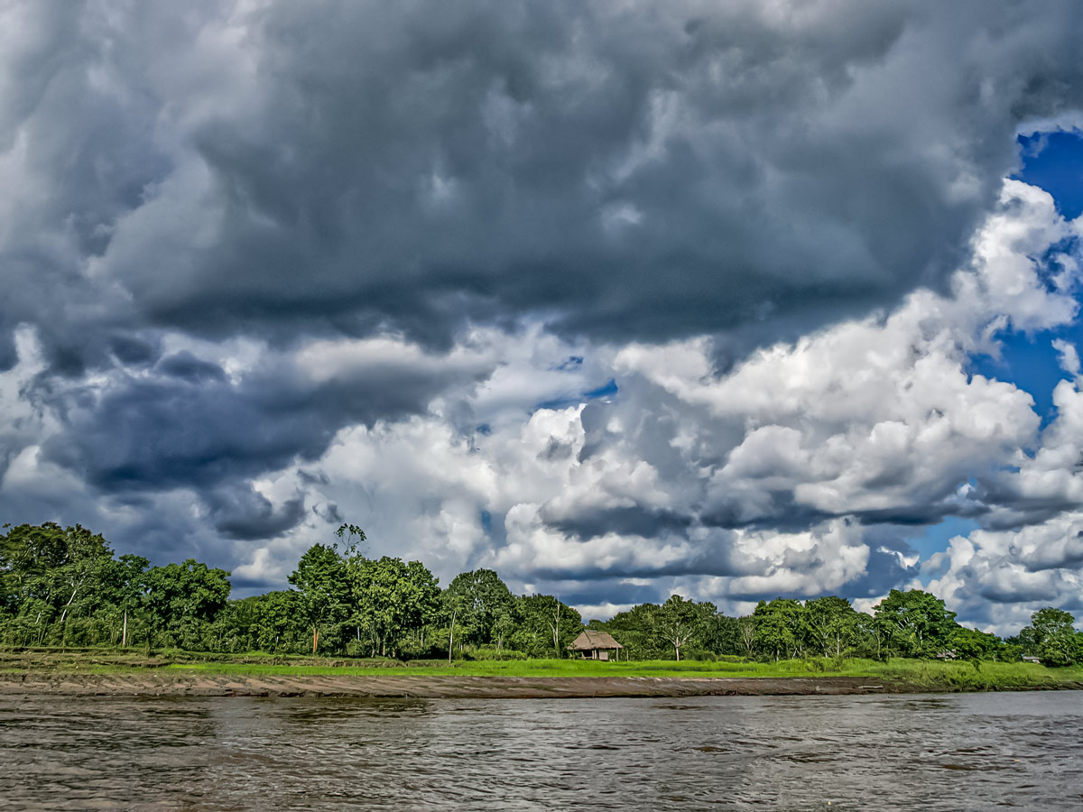 Storm clouds over river bank Peruvian Amazonia survival training expedition