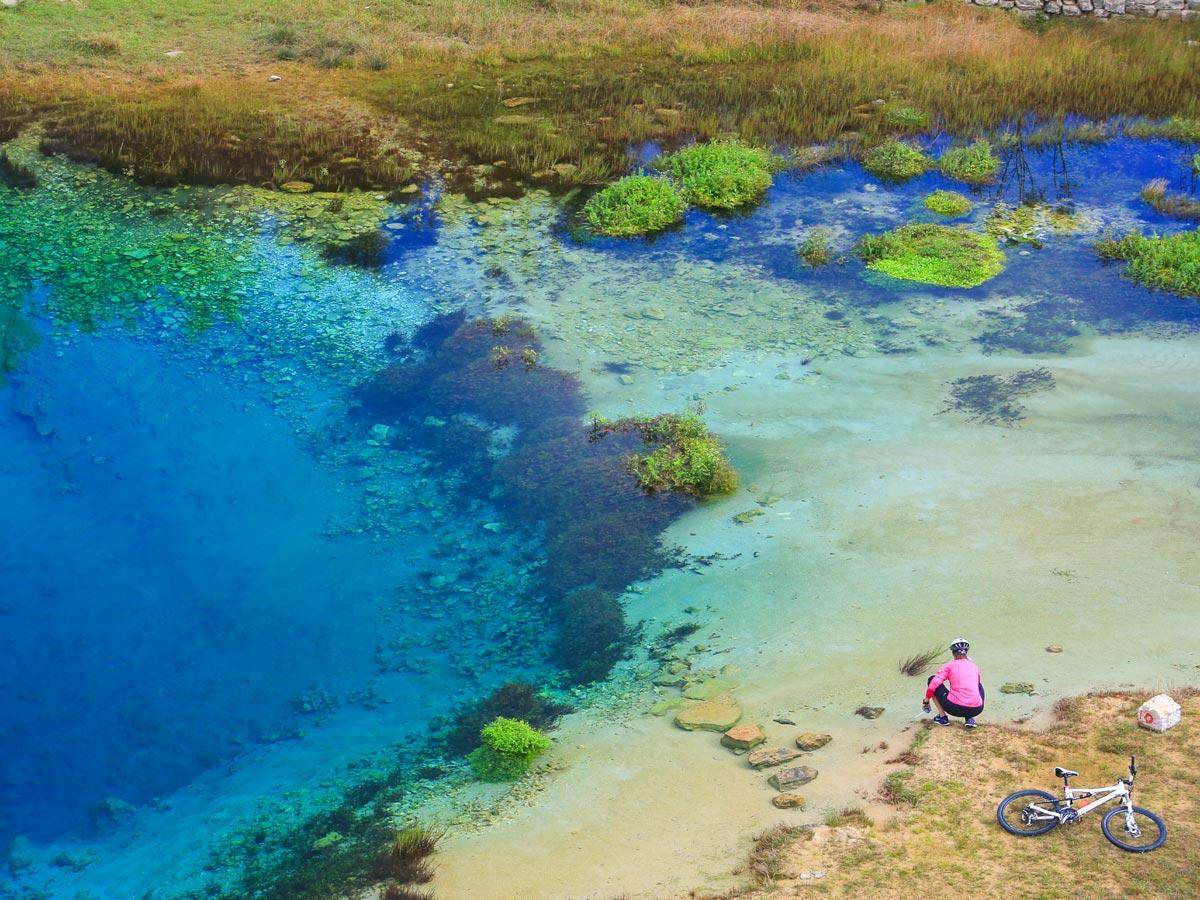 Clear blue pond biking Croatia