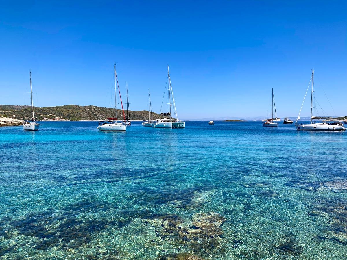 Clear water mediterranean sea sailboats