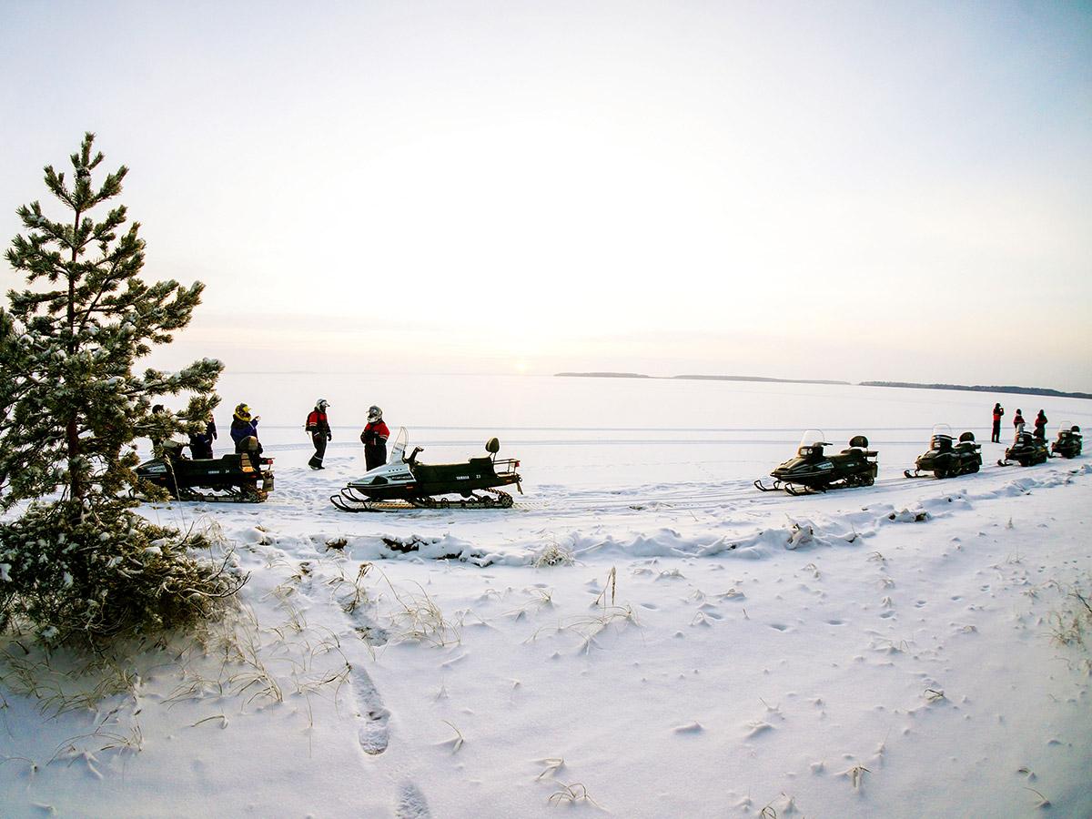 Karelia multi sport tour in Russia includes riding the snowmobiles in wilderness
