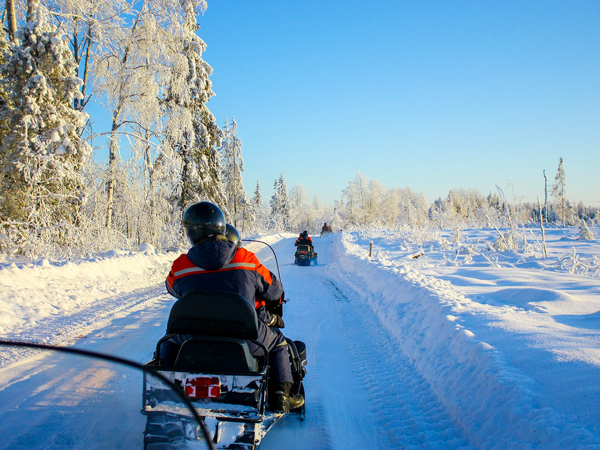 Riding the snowmobiles on guided multi sport tour in Karelia