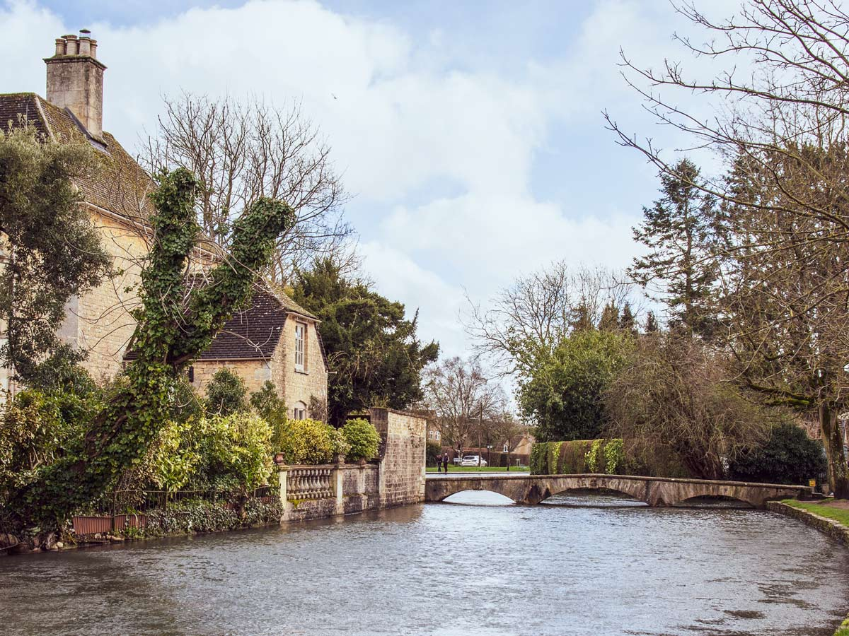 Bourton on the water river bridge Cotswold England
