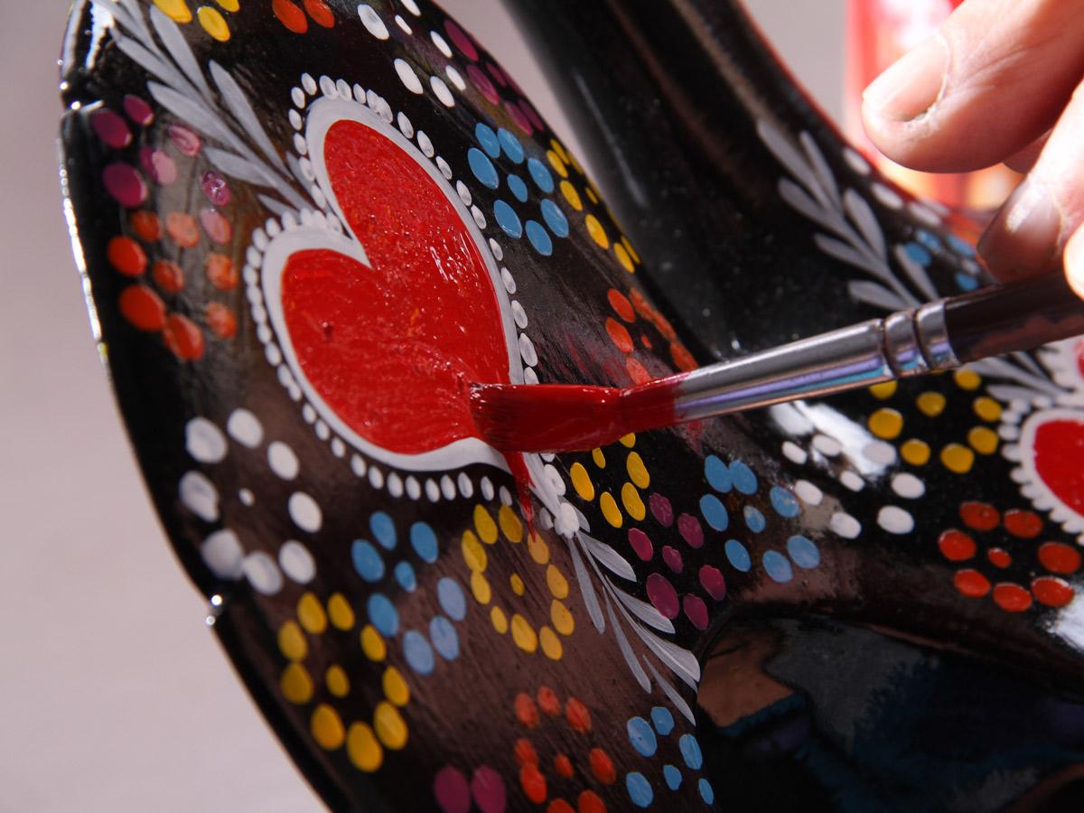 Hand painted heart artwork along family bike tour Minho Portugal