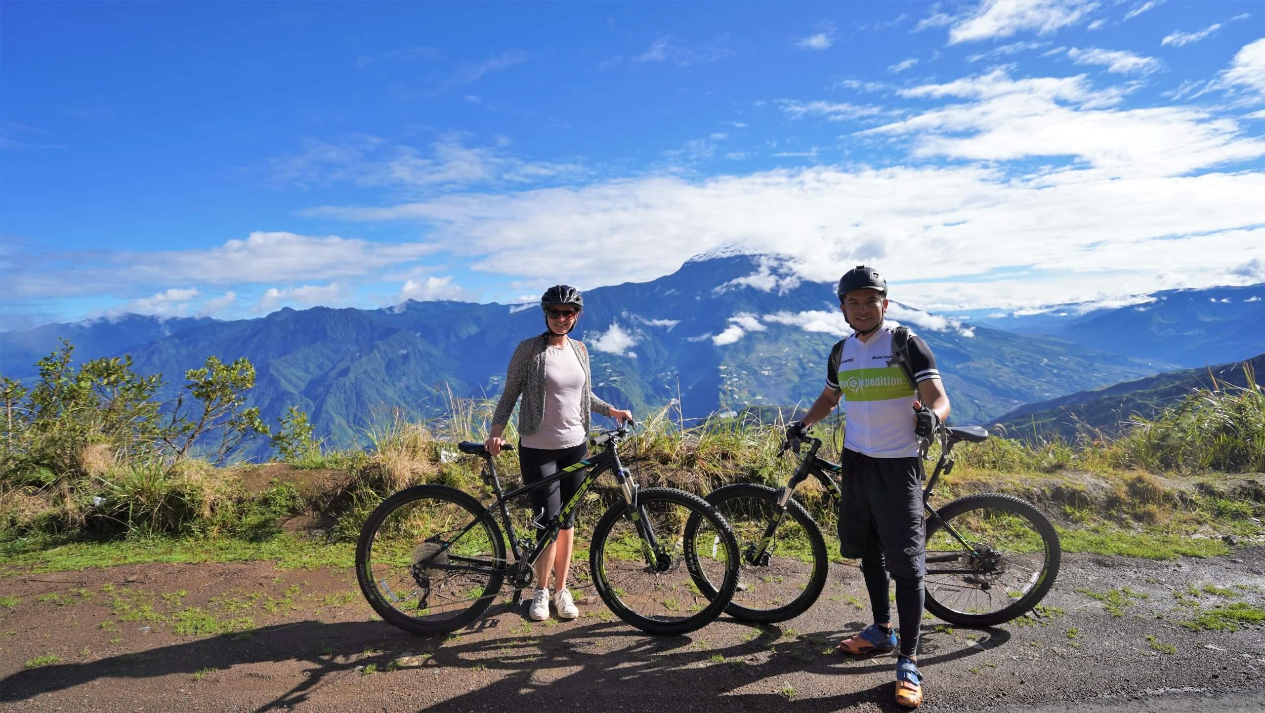 Cyclists posing in front of the mountain view (Ecuador rainforest biking tour)
