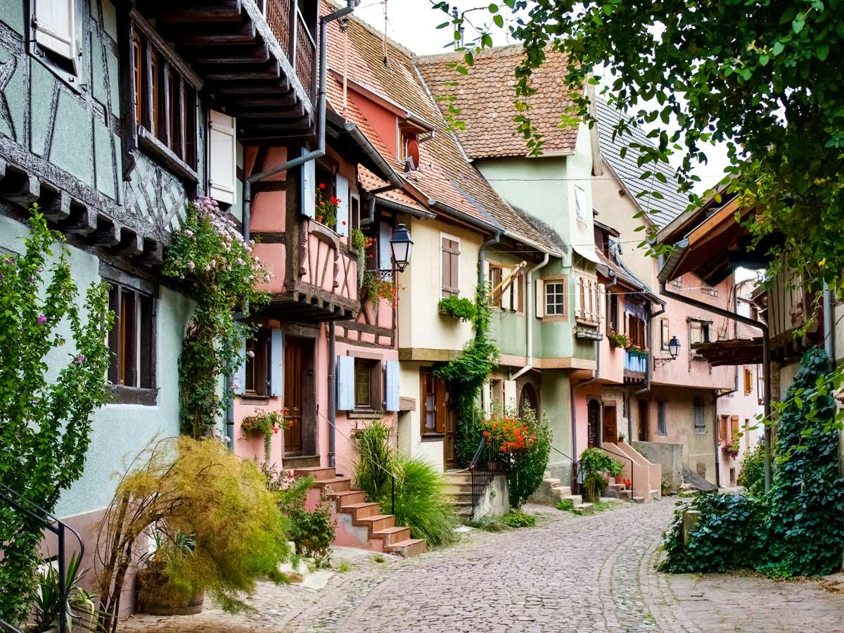 Exploring quaint French villages and cobblestone street exploring wine route Alsace France