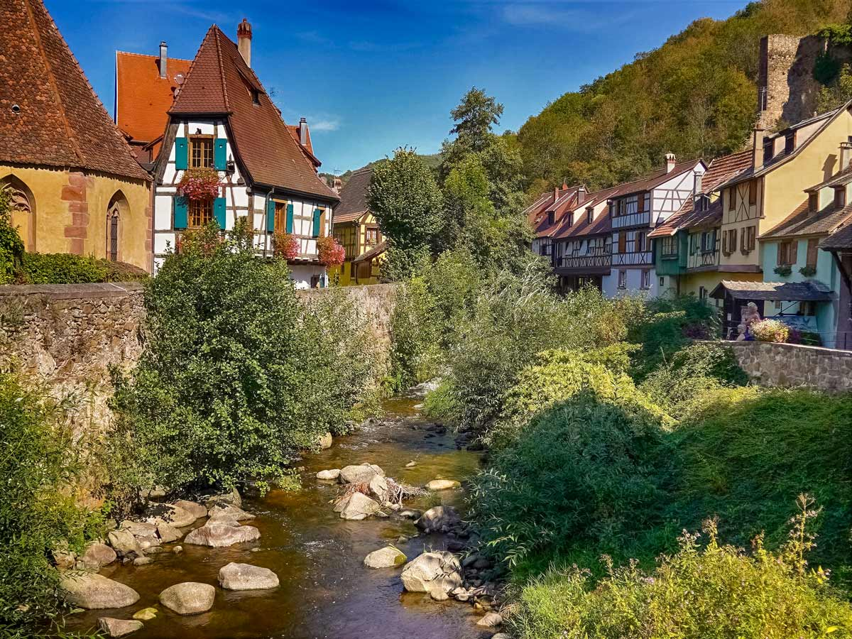 Kayserberg village on the river exploring wine route Alsace France