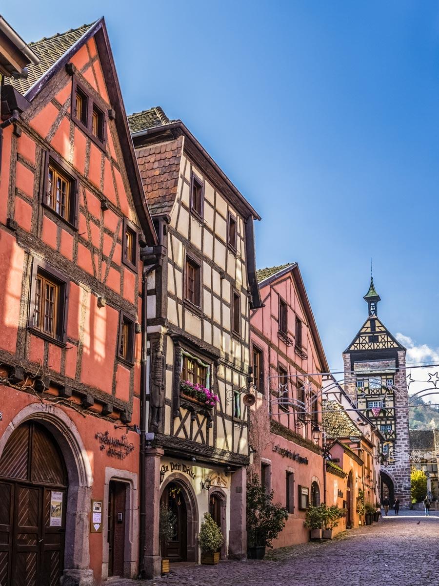 Riquewihr village town houses on cobblestone street exploring wine route Alsace France