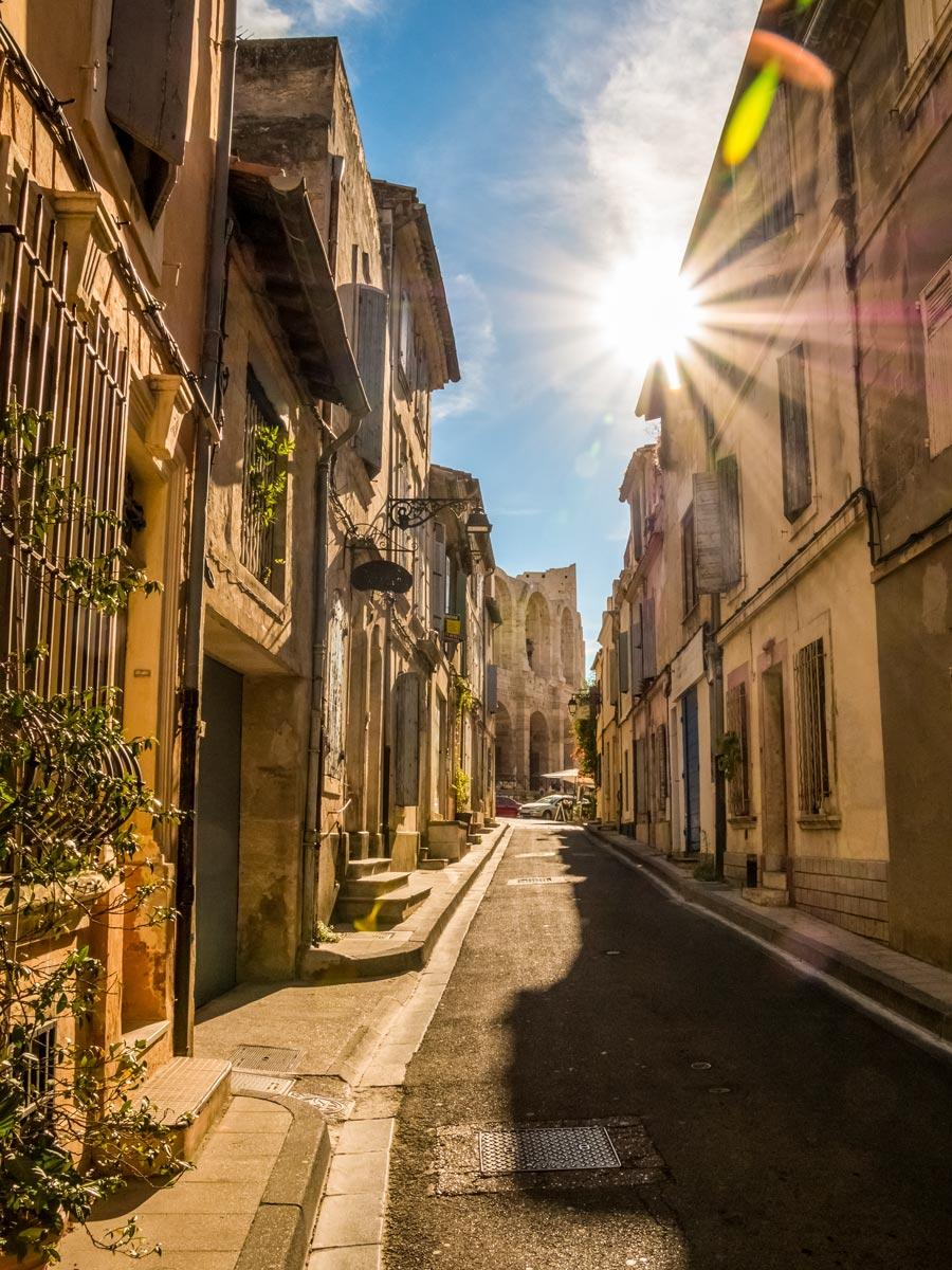 Arles city historic center old stone buildings lining cobblestone streets exploring Provence Alpilles France