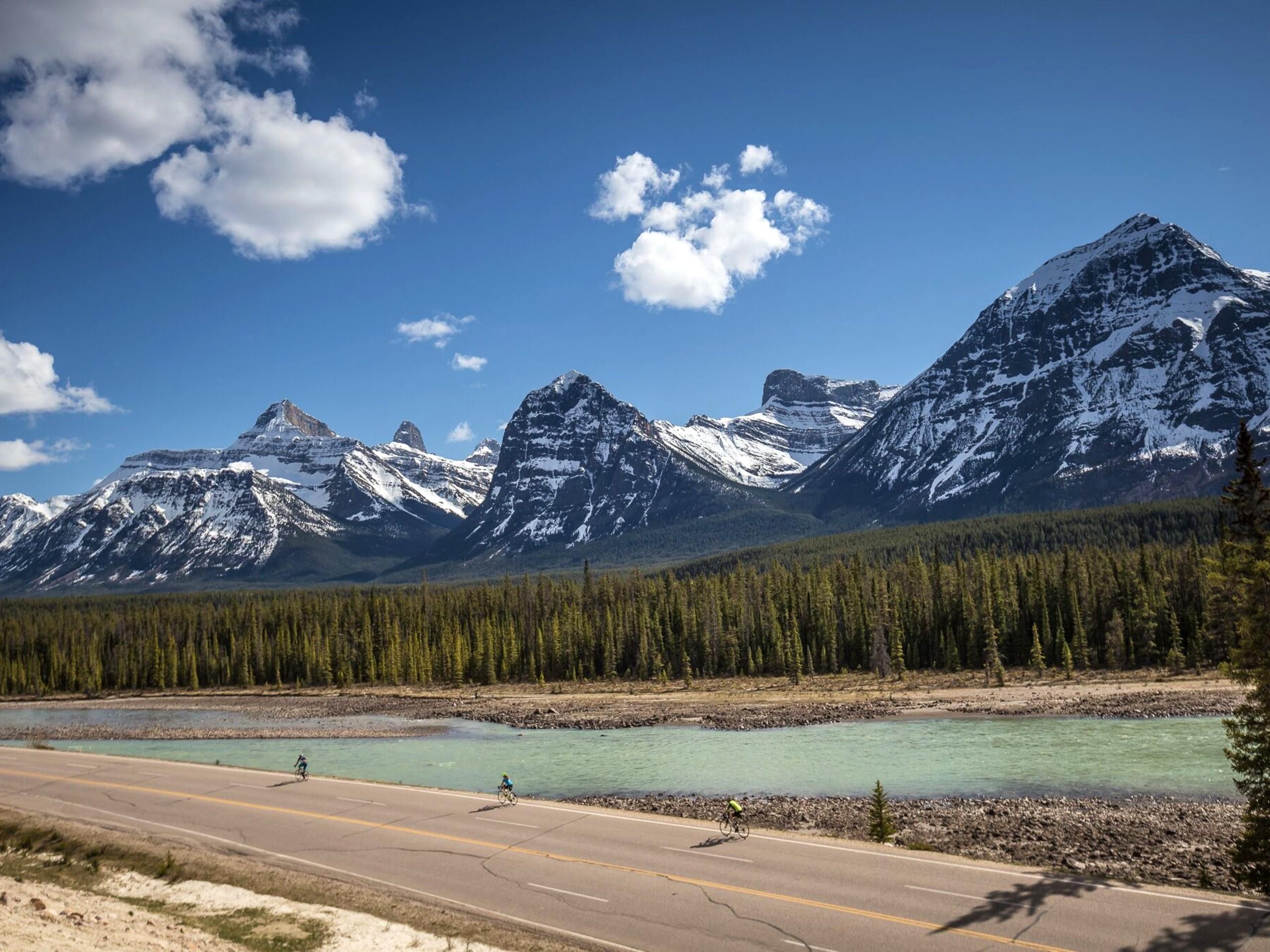 Stunning mountain peaks near the river, seen on a biking tour in Alberta